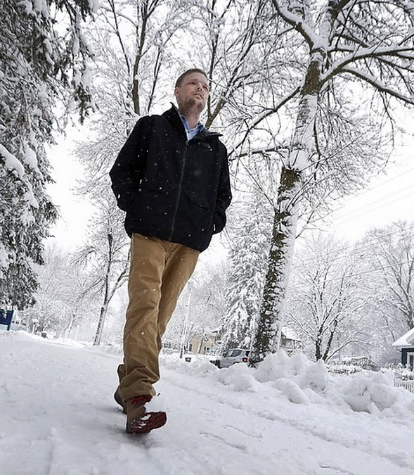 "In this Jan. 25, 2017, photo, face transplant recipient Andy Sandness walks to the Saint Marys Hospital campus at Mayo Clinic in Rochester, Min. Sandness can pinpoint the day he looked normal. About three months after the procedure, he was in an elevator with a little boy who glanced at him, then turned to his mother without appearing scared or saying anything. ""I knew then,"" he says, ""that the surgery was a success."" (AP Photo/Charlie Neibergall)"