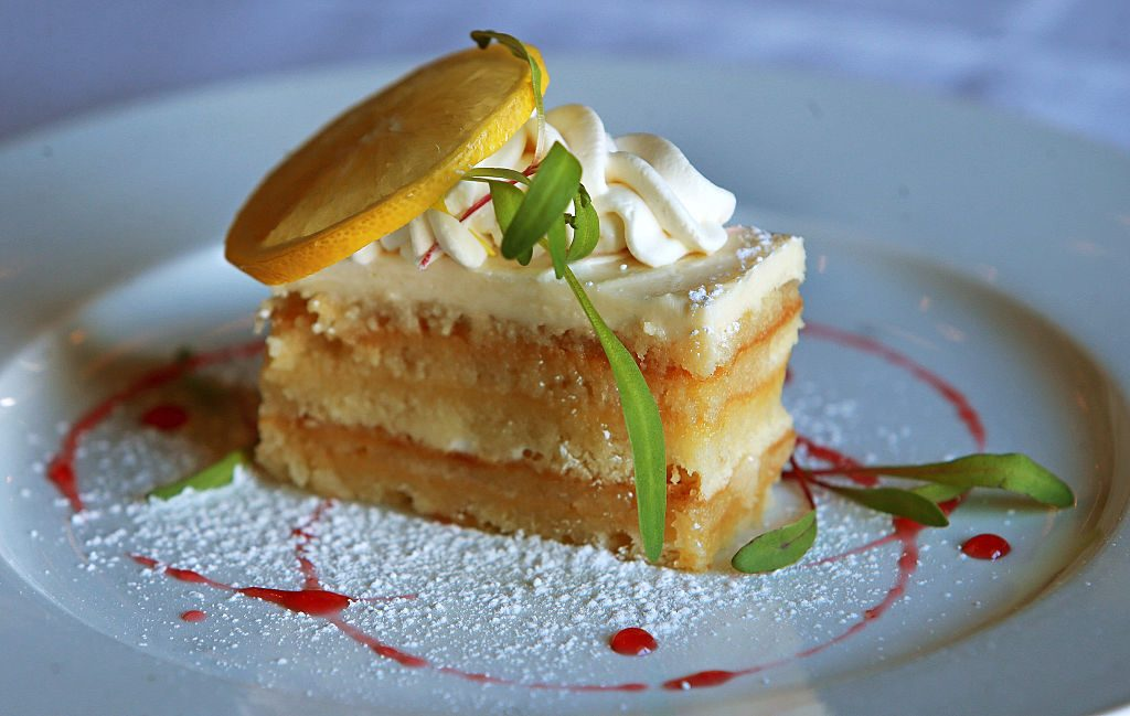 LYNNFIELD, MA - MARCH 31: A slice of layered lemon cake at Davio's is pictured. (Photo by Jim Davis/The Boston Globe via Getty Images)