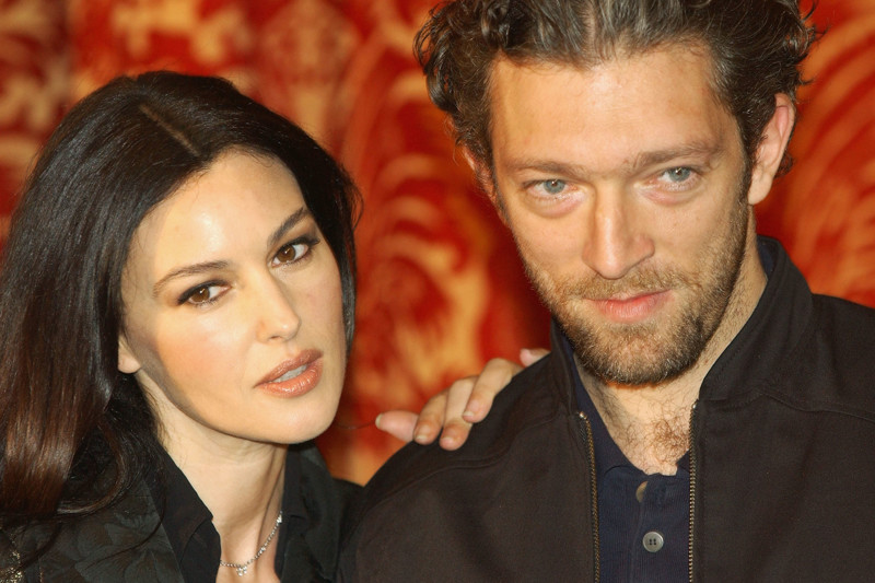 """ROME - OCTOBER 29: French Actor Vincent Cassel and his wife Italian actress Monica Bellucci attend a photocall to promote their latest movie """"Agents Secrets"""" at the Grand Hotel on October 29, 2004 in Rome, Italy. (Photo by Franco Origlia/Getty Images)"""