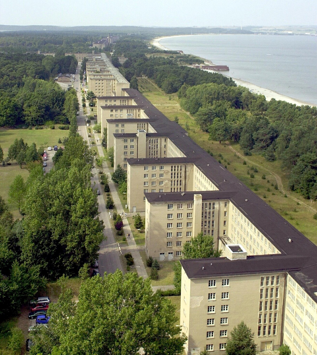 "(FILES) - File photo taken 16 August 2000 shows an aerial view of the 4.5 kilometers long so-called ""colossus of Ruegen""-complex in Prora on the Baltic Sea island Ruegen. The giant holiday center built in the Nazi-era of German dictator Adolf Hitler at the end of the 1930s has been sold by  auction for 625,000 euros.    AFP PHOTO    DDP/JENS KOEHLER    GERMANY OUT"