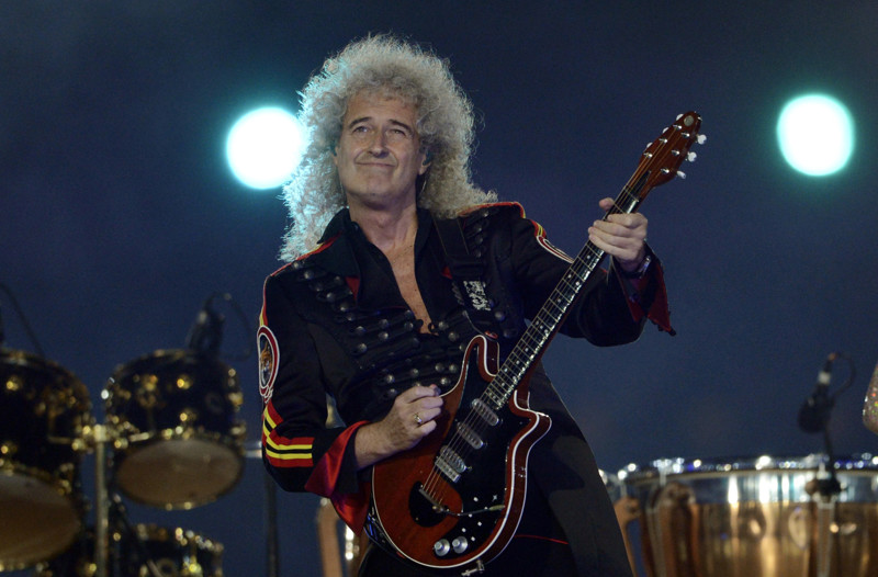 Queen's guitar player Brian May performs at the Olympic stadium during the closing ceremony of the 2012 London Olympic Games in London on August 12, 2012. Rio de Janeiro will host the 2016 Olympic Games. AFP PHOTO / ADRIAN DENNIS (Photo credit should read ADRIAN DENNIS/AFP/GettyImages)