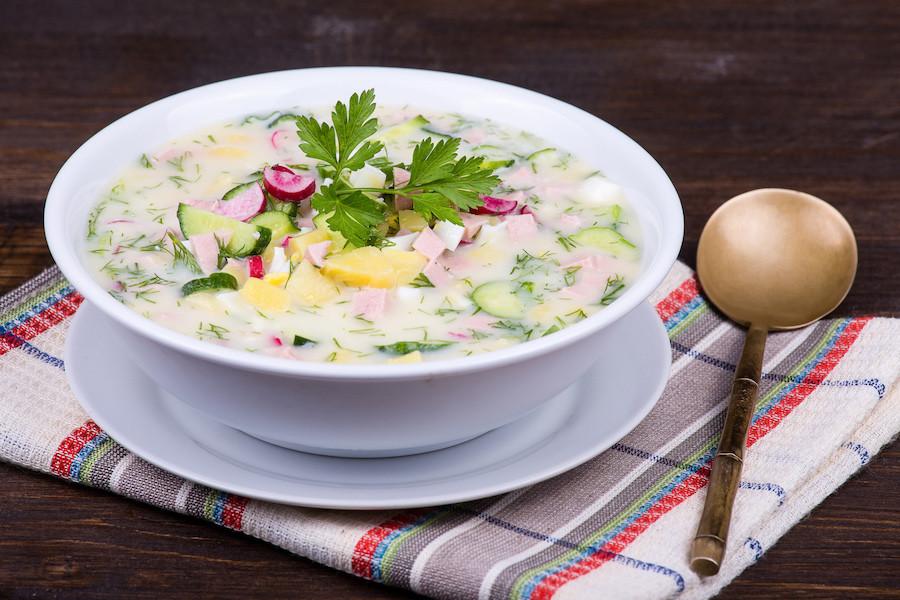 Close-up of russian cold vegetable soup on yogurt (sour-milk) base - okroshka